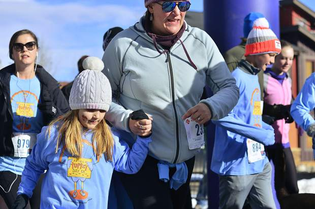 Families start the sixth annual Turkey Day 5k Fun Run in Frisco on Thursday.