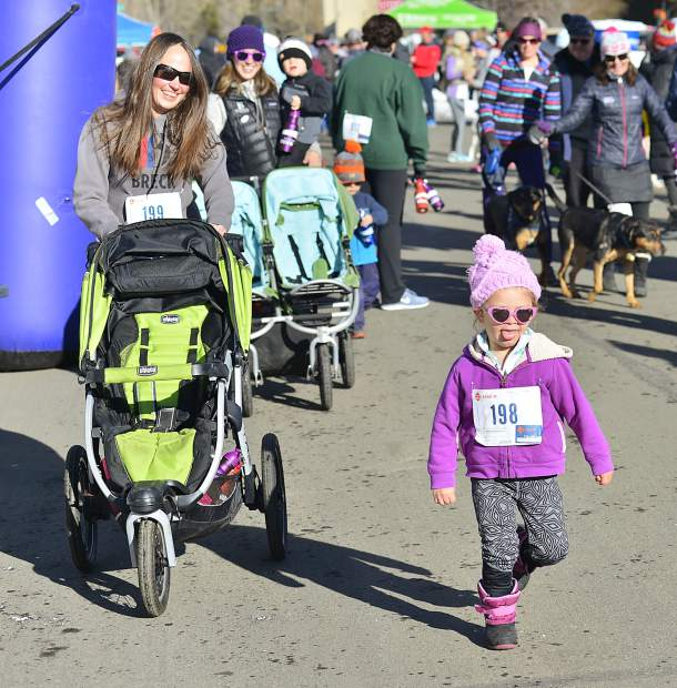 Three-year-old Alya Diaz takes off at the start of Thrusday's Turkey Day 5k Fun Run in Frisco.
