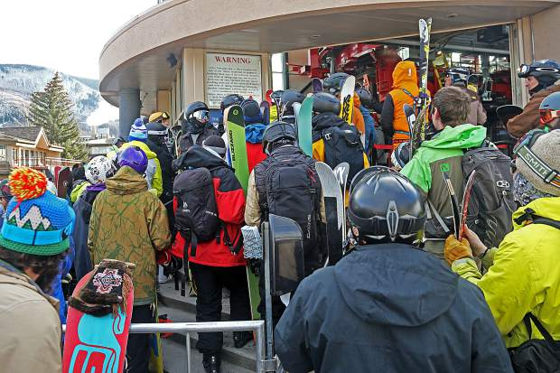 People wait in line to be among the first up Aspen Mountain for opening day on Saturday, Nov. 17, 2018.