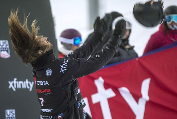 Patrick Burgener, of Switzerland, tosses his helmet in the air following his last run of the Toyota U.S. Grand Prix World Cup halfpipe snowboard men's finals Saturday, Dec. 8, at Copper Mountain. Burgener placed 4th.