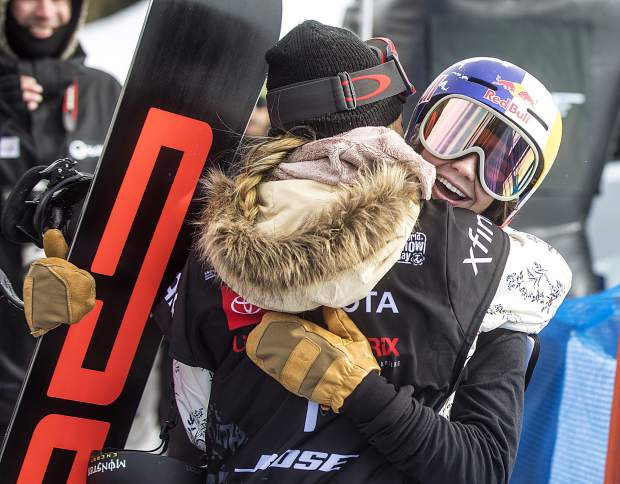 Toby Miller, of California, hugs teammate Chloe Kim following the Toyota U.S. Grand Prix World Cup halfpipe snowboard men's finals Saturday, Dec. 8, at Copper Mountain.
