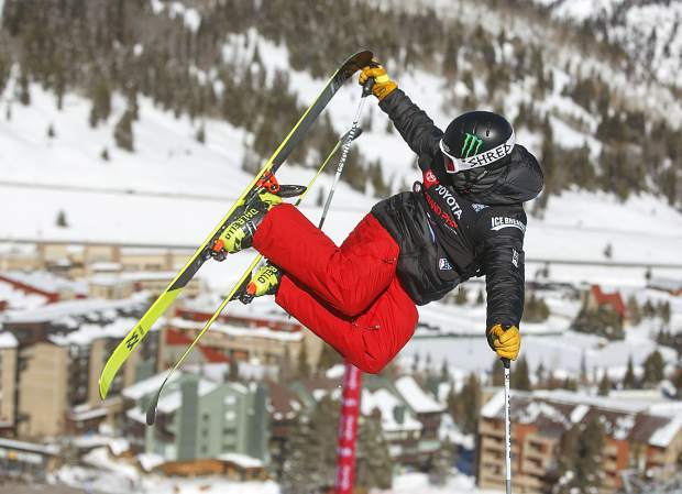 Toyota U.S. Grand Prix halfpipe freeski competitor and Breckenridge native Jaxin Hoerter executes a trick high above the Copper Mountain Resort halfpipe as part of Tuesday training for Wednesday's Grand Prix freeski qualifying round.