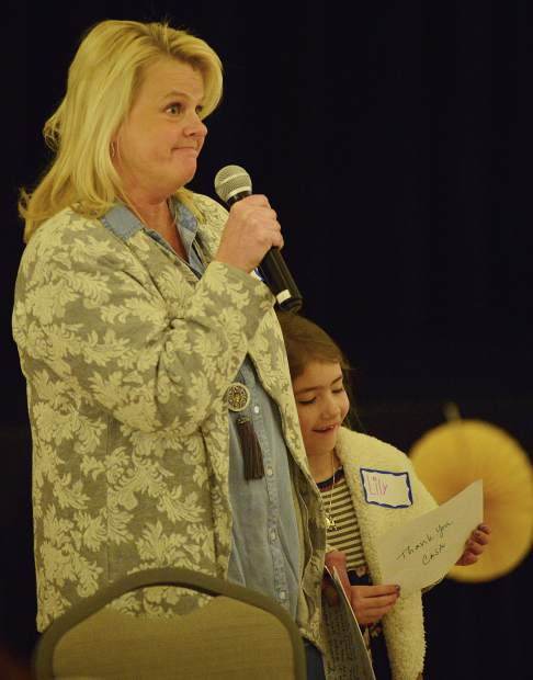 Amy Geppi talks about how the nonprofit helped her and her husband adopt a 6-year-old daughter, Lily, during CASA of the Continental Divide's celebration dinner Wednesday night at the Silverthorne Pavilion.