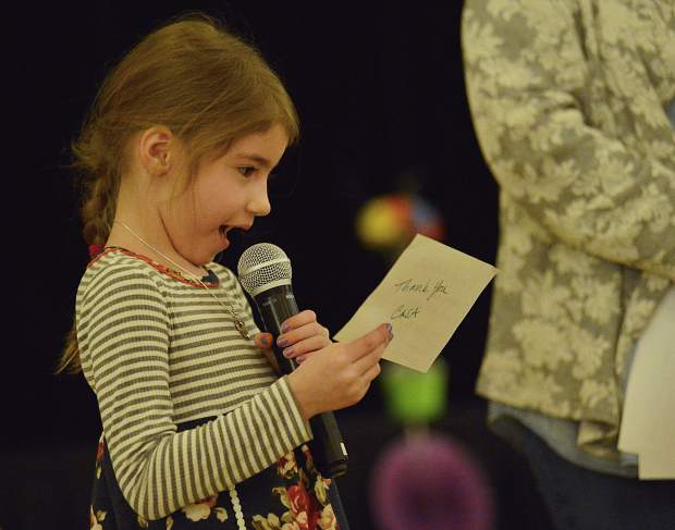 Six-year-old Lily, who was adopted by Amy Geppi and Bary Rubenstein in 2012, thanks the crowd assembled Wednesday at the Silverthorne Pavilion for CASA of the Continental Divide's celebration dinner.