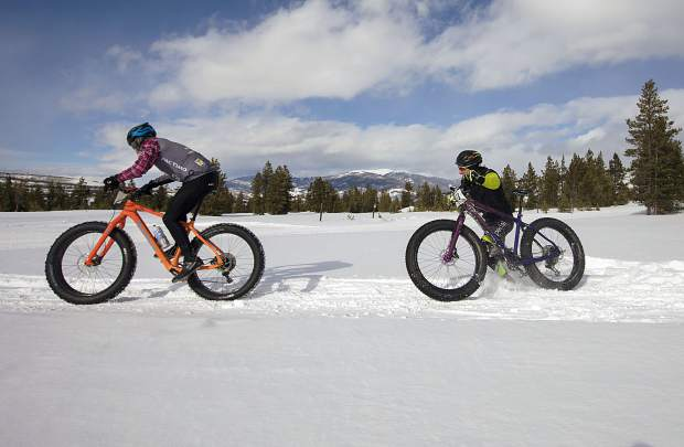 A bicyclist climbs back onto the packed trail after taking a fall in the snow during the 3rd Annual Frisco Freeze Fat Bike Race Saturday, Feb. 23, on the Frisco Peninsula.