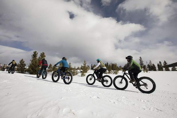 Participants in the 3rd Annual Frisco Freeze Fat Bike Race pedal in the snow Saturday, Feb. 23, on the Frisco Peninsula.