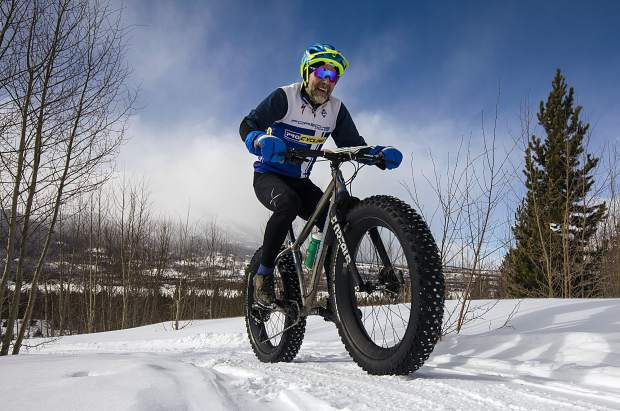 A bicyclist participant pedals uphill in the snow during the 3rd Annual Frisco Freeze Fat Bike Race Saturday, Feb. 23, on the Frisco Peninsula.