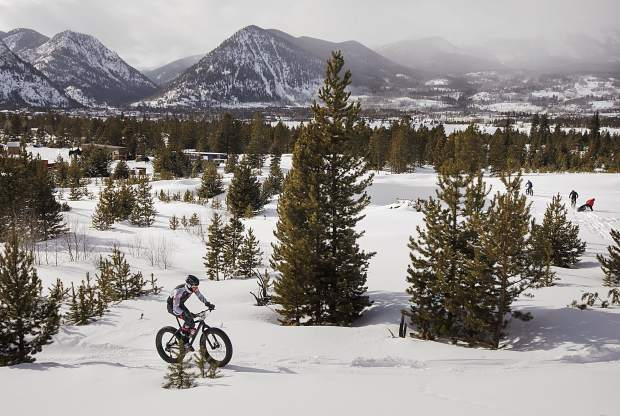 A bicyclist pedals uphill in the snow during the 3rd Annual Frisco Freeze Fat Bike Race Saturday, Feb. 23, on the Frisco Peninsula.