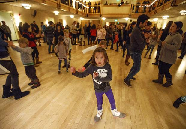 A girl dances along with the salsa lessons led by Remezcla band during the First Friday celebrating the latino community, Feb. 1, at the Silverthorne Pavilion.