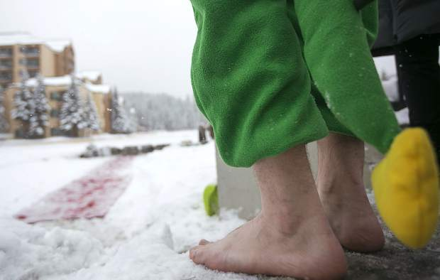 A participant awaits his turn to jump during Ullr Ice Plunge event Friday, Jan. 11, in Breckenridge.