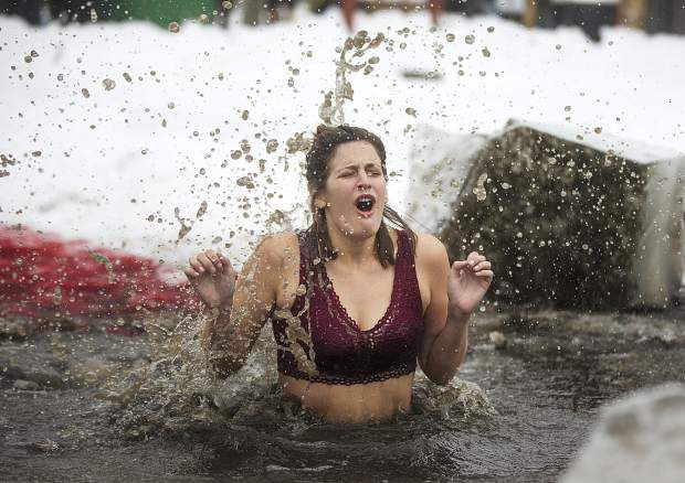A participant reacts following the jump into Maggie's Pond in part of Ullr Ice Plunge event Friday, Jan. 11, in Breckenridge.