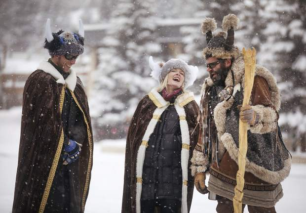 Ullr King and Queen Jay and Erin Beckerman share a laugh with Ullr while watching Ullr Ice Plunge event at Maggie's Pond Friday, Jan. 11, in Breckenridge.