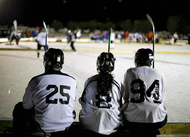 Spectators and thousands of hockey players gather at North Pond Park to participate in the Pabst Colorado Pond Hockey tournament Friday night, Feb. 15, in Silverthorne.