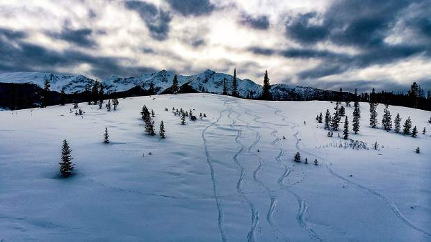 A skin track and ski tracks with Tenmile Range in background.
