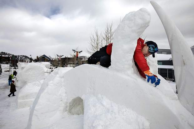 Tserendash Batmunkh, of Mongolia, carves the Discovery masterpiece with his team for the International Snow Sculpture Championships Wednesday, Jan. 23, in Breckenridge.