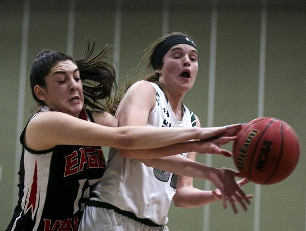 Summit High School junior Anna Tomlinson is fouled during the Tigers' 56-38 victory over the Devils on Saturday, Feb. 9, at Summit High School in Breckenridge.