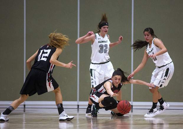 Summit High School and Eagle Valley High School players battle for a loose ball during the Tigers' 56-38 victory over the Devils on Saturday, Feb. 9, at Summit High School in Breckenridge.