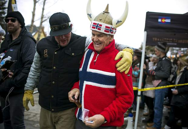 Ullr Fest founder Trygve Berge celebrate the 56th annual event with hundreds of other snow worshippers Thursday, Jan. 10, on Main Street in Breckenridge.