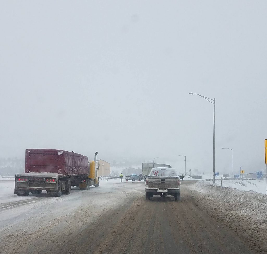Colorado State Patrol and the Silverthorne Police Department man a safety closure at Exit 205 on Interstate 70