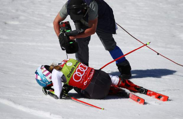United States' Mikaela Shiffrin is filmed by a cameraman after winning a women's alpine ski giant slalom title, in Soldeu, Andorra, Sunday, March 17, 2019. (AP Photo/Alessandro Trovati)