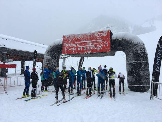 Jeremiah Vaille of Summit Cove (blue, fourth from right) toes the starting line at Aspen Mountain at the beginning of Sunday's U.S. Ski Mountaineering Association Vertical National Championship at Aspen Mountain in Aspen. Vaille won the men's cadet division race.