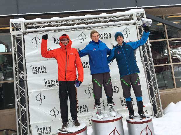 Jeremiah Vaille of Summit Cove (center) celebrates on the podium after winning the men's cadet division at Sunday's U.S. Ski Mountaineering Association Vertical National Championship at Aspen Mountain in Aspen.