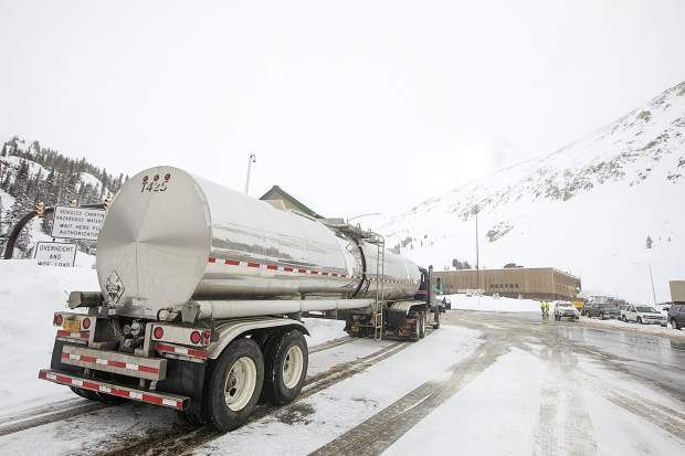 A hazmat truck awaits before the Eisenhower Tunnel on Interstate 70 during snowstorm Thursday, March 7, at Loveland Pass.