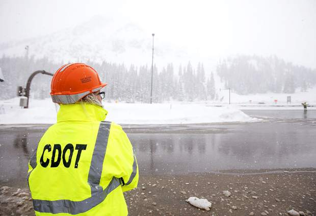 CDOT spokeperson Tracy Trulove eyes Interstate 70 during snowstorm Thursday, March 7, at Loveland Pass.