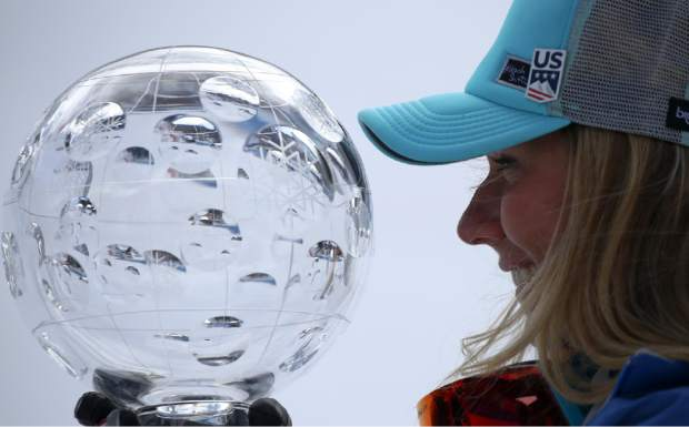Mikaela Shiffrin holds the women's World Cup overall trophy at the alpine ski World Cup finals in Soldeu, Andorra on March 17.