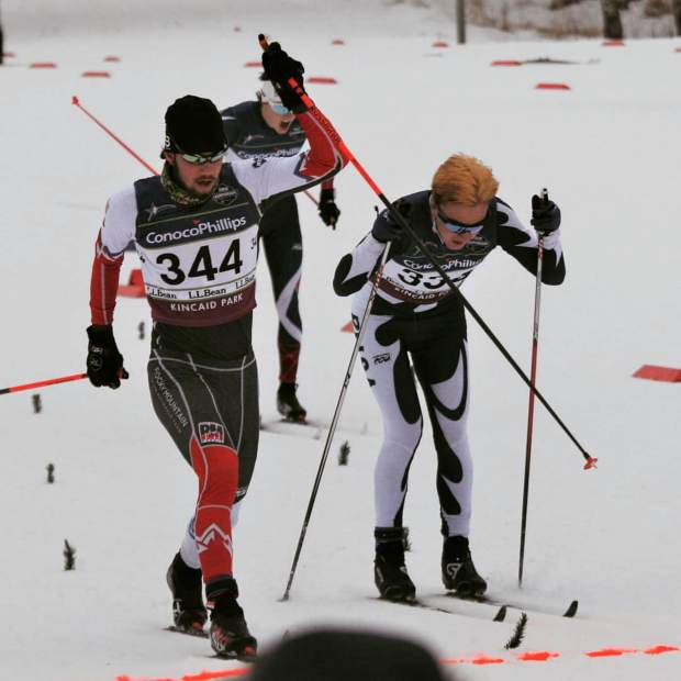 Summit Nordic Ski Club skier and Summit High School senior Peter Haynes (left) lunges for the finish line at last week's U.S. Cross Country Junior Nationals in Anchorage, Alaska.