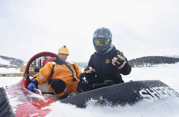 Brian Metzger, a technician with the special operations division for the Summit County Sherif''s Office, prepares to drive Jesus Munoz out into the middle of Dillon Reservoir. The vehicle is a 1987 hovercraft donated to the sheriff's office by the Rotary Club years ago.