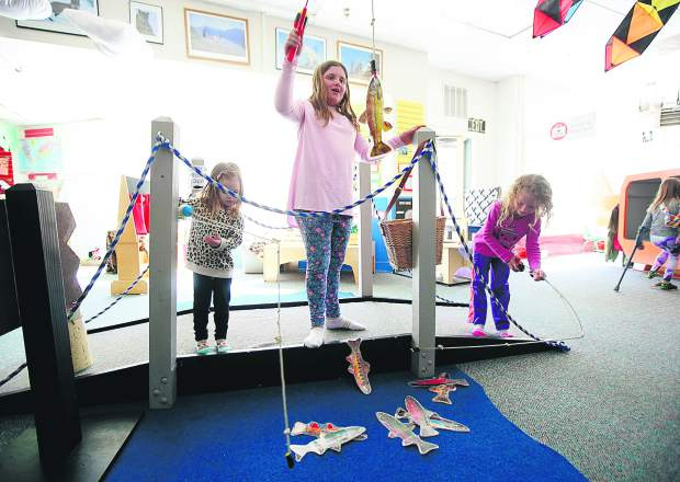 Children practice their fishing skills at the wildlife section at Mountain Top Children's Museum Wednesday, March 27, in Breckenridge.
