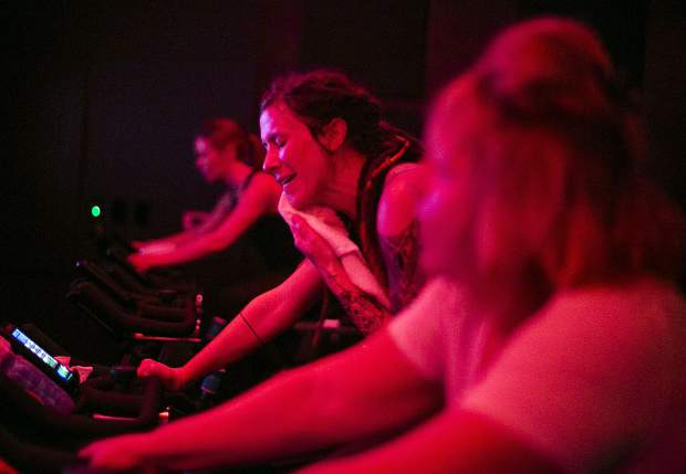 Lindsay Eland wipes sweat during spinning class at the Psycle 9600 Spin Studio Wednesday, March 6, at Main Street Station in Breckenridge.