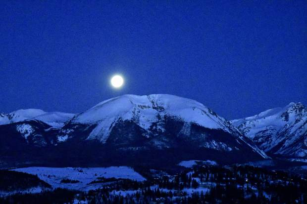 Moon seen with Buffalo Mountain in foreground.