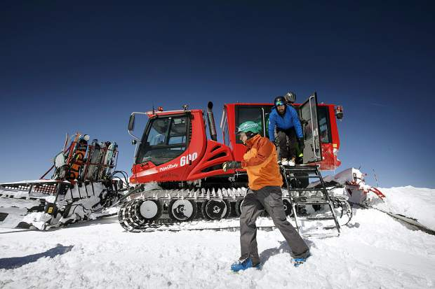 Skiers and snowboarders hop off the Ridge Cat snowcat machine, a Pisten Bully 600, on Loveland Ski Area Friday, March 15, for high alpine skiing.