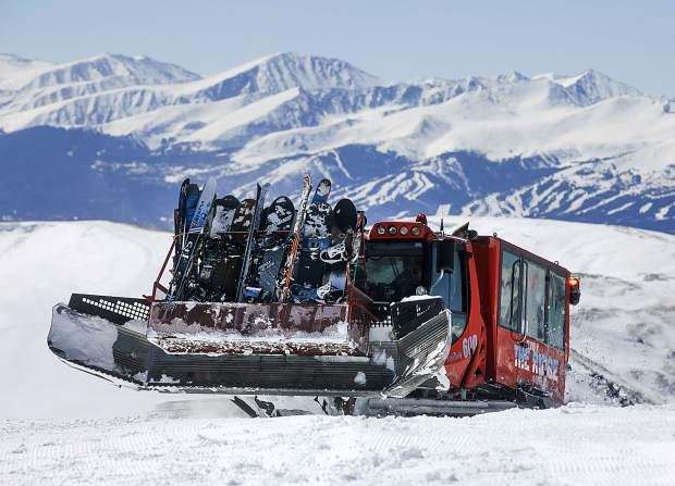 A Ridge Cat snowcat machine carries skiers and snowboarders higher up on Loveland Ski Area Friday, March 15, for above tree line skiing on fresh March snow.