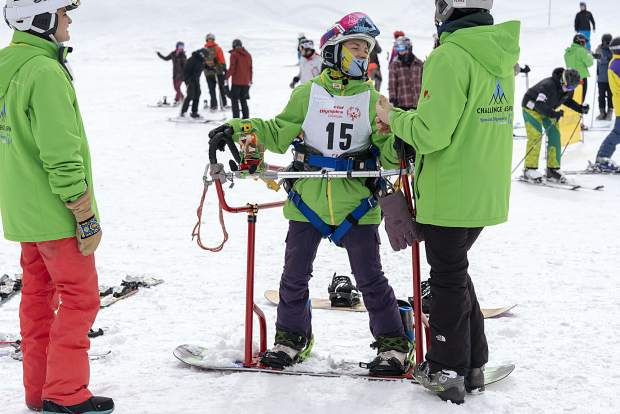 A snowboarder is aided with adaptive equipment during this past weekend's 2019 Special Olympics Colorado State Winter Games at Copper Mountain Resort.