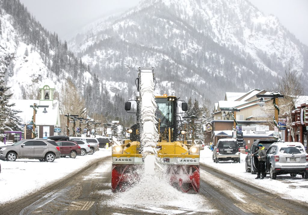 Town of Frisco works to clear snow off Main Street Friday, March 1.