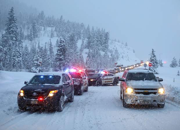 Summit County Sheriff Department deputies block Interstate 70's entrance from Frisco Sunday evening, March 3.