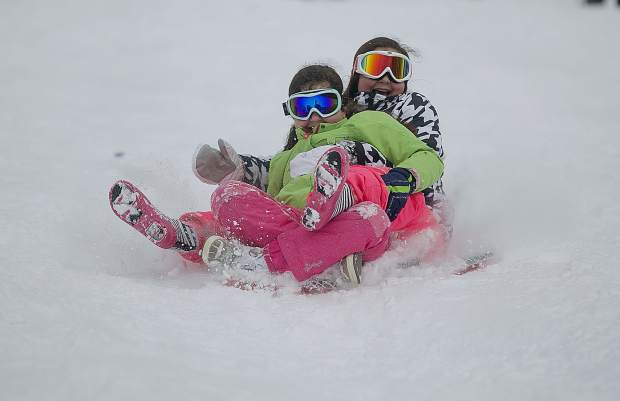 People enjoy sledding at Carter Park Wednesday, March 13, in Breckenridge.