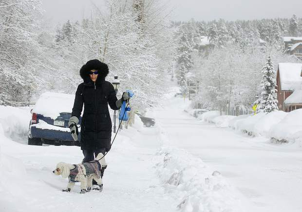 Mary Lou Johns with her dog, Lucky, as they walk along Washington Avenue Wednesday, March 13, in Breckenridge.