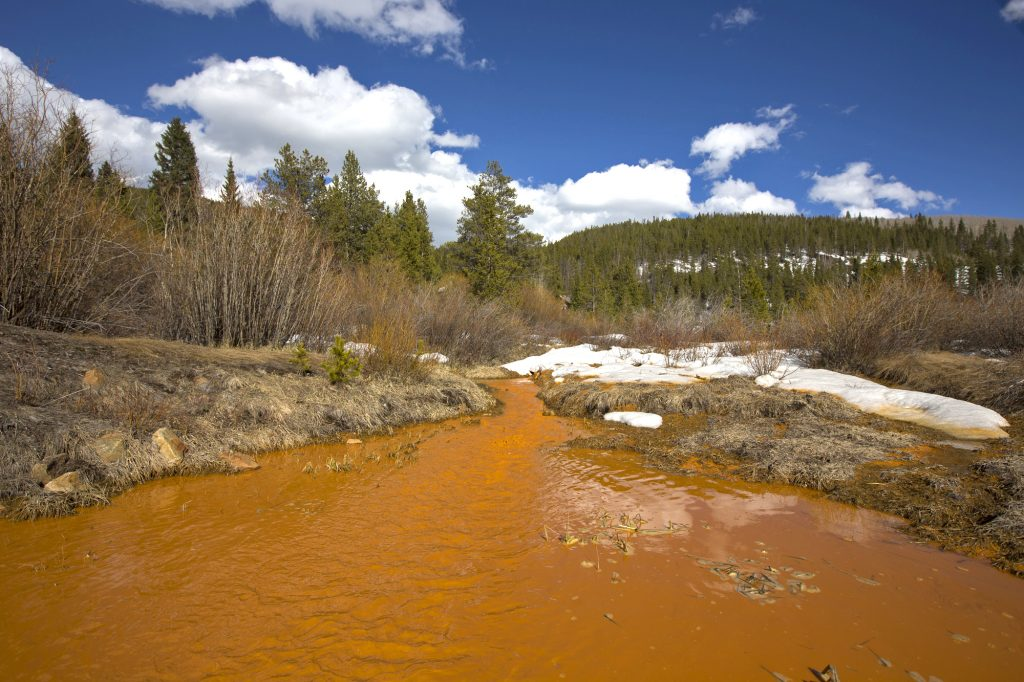 The heavy metal-filled stream in Illinois Gulch flows into Blue River Saturday afternoon, April 27, along Boreas Pass Road in Breckenridge. The river flows into the Dillon Reservoir, the source of water for Denver metro area.