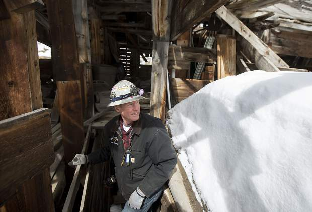 Country Boy Mine guide Paul Hintgen takes a look around in the old standing mill Wednesday, April 3, near Breckenridge.