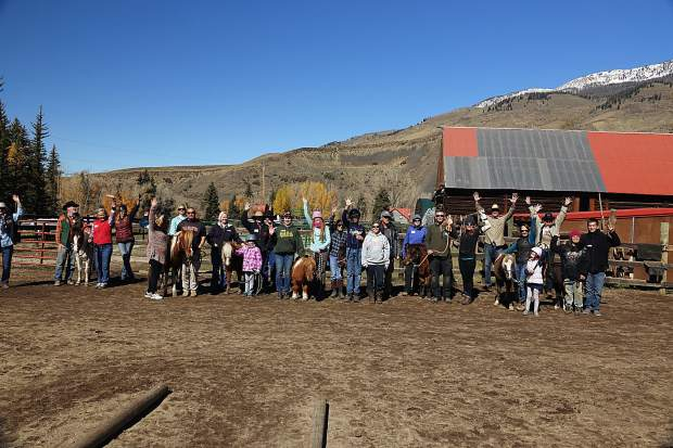 A group from Building Hope poses for a group shot with horses from the Blue River Horse Center north of Silverthorne. The center, a local nonprofit that takes in rescued horses, is getting ready for another summer of work and will be introducing this year's horses to the community during an open house on May 11.