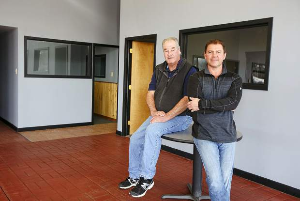 Business partners Tim Weiers, left, and Shane Rougemont are shown inside Red Mountain Autos, a new, used car dealership that's opening this week in the same Silverthorne building where Hudson Auto Source used to be.