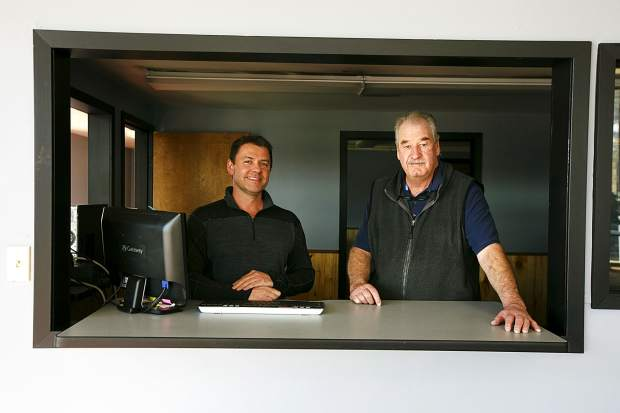 Business partners Shane Rougemont and Tim Weiers are shown inside Red Mountain Autos, a new, used car dealership that's opening this week in the same Silverthorne building where Hudson Auto Source used to be.