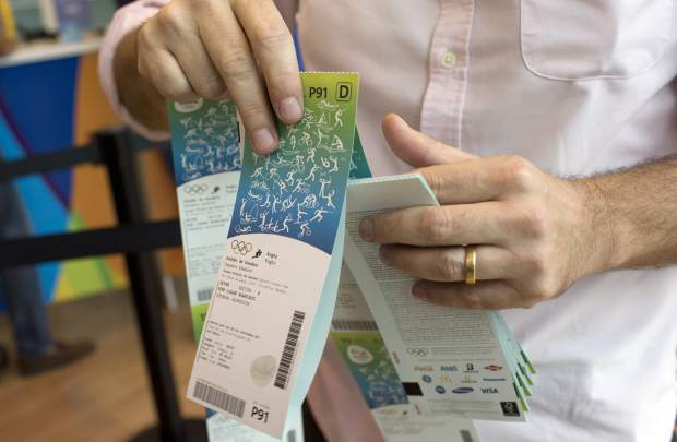 A man handles the Olympic tickets he just purchased at a shopping mall in Rio de Janeiro, Brazil in 2016. Tokyo Olympic organizers launched their ticket website on Thursday.