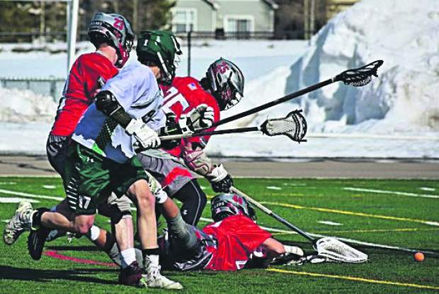Sights from the Summit High School varsity boys lacrosse team's 11-2 loss on Monday at home at Tiger Stadium near Breckenridge.
