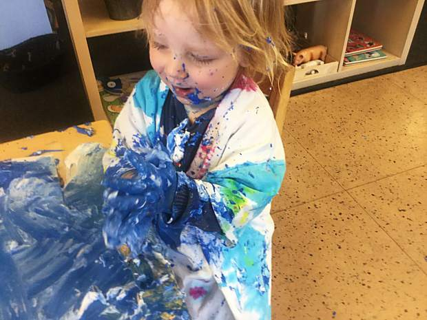 Daniel Ness Monteverde, 1, paints a work for the Timberline Learning Center's second annual art show. In addition to paiting and illustration, other mediums at the show include collage and storytelling.