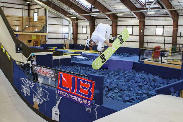 A snowboarder rides the old Snowflex surface at the Woodward Copper barn during the 2010 Tricks for Treats event. Woodward Copper replaced the Snowflex surfaces with Skatelite in 2014.